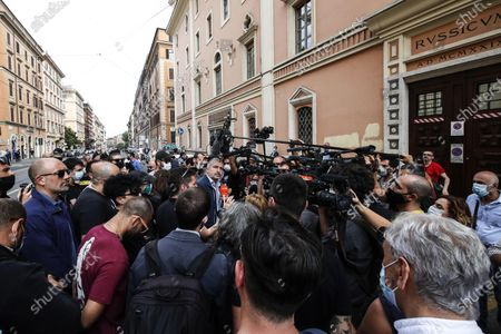 The leader of far-right movement 'Casapound', Simone Di Stefano (C), speaks to the media representatives in front of the movement's headquater after the preventive seizure of their proprety, with reference to the crime of abusive occupation, ordered by the Rome prosecutor, in Rome, Italy, 04 June 2020. The measure was signed at the end of an investigation conducted by the Digos (General Investigations and Special Operations Division,) of the Rome Police Headquarters.
