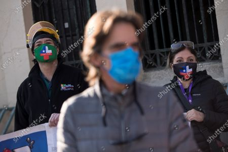 Activists wear face masks as they take part in a protest by healthcare professionals' and consumers' groups against the management of the ongoing pandemic of the COVID-19 disease caused by the SARS-CoV-2 coronavirus by the government of President Sebastian Pinera and Health Minister Jaime Manalich held in front of the Barros Luco Trudeau Hospital in the commune of San Miguel in Santiago de Chile, Chile, 04 June 2020.