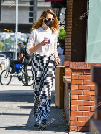 Whitney Port is seen wearing a mask as she grabs a coffee