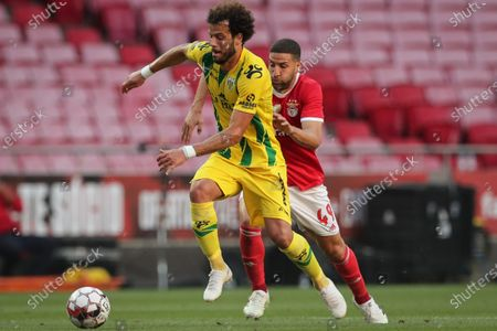 Benfica's player Adel Taarabt (R) in action against Tondela's oponent Yohan Tavares (L) during their Portuguese First League soccer match, held at the Luz stadium in Lisbon, 04 June 2020.