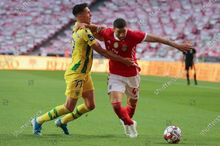 Benfica's player Adel Taarabt (R) in action against Tondela's oponent Richard Rodrigues (L) during their Portuguese First League soccer match, held at the Luz stadium in Lisbon, Portugal, 04 June 2020.