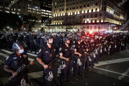 New York Police Department officers stand in formation after arresting multiple protesters marching after curfew on Fifth Avenue, in New York. Protests continued following the death of George Floyd, who died after being restrained by Minneapolis police officers on May 25
