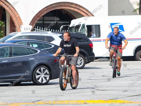 Arnold Schwarzenegger and Ralf Moeller are seen on a morning bike ride