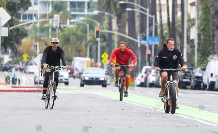 Arnold Schwarzenegger, his son Patrick Schwarzenegger, and Ralf Moeller are seen on a morning bike ride