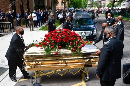 George Floyd's casket leaves Trask Worship Center after the memorial for the 46 year old black man who died in police custody in Minneapolis, Minnesota, USA, 04 June 2020. A bystander's video posted online on 25 May, appeared to show George Floyd, 46, pleading with arresting Minneapolis Police officers that he couldn't breathe as an officer knelt on his neck. The unarmed Black man later died in police custody. According to news reports on 29 May, Derek Chauvin, the police officer in the center of the incident has been taken into custody and charged with murder in the George Floyd killing. On 03 June three other officers on scene were charged with aiding and abetting murder of second degree.