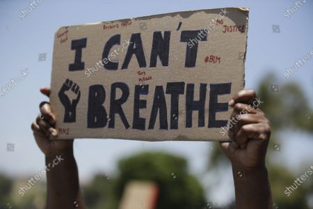 Demonstrators holds a sign in Santa Clarita, Calif., during a protest over the death of George Floyd who died May 25 after he was restrained by Minneapolis police