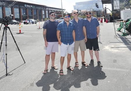 Members of the Eli Young Band, from left, Chris Thompson, Mike Eli, Jon Jones and James Young pose for a photo before performing a concert in the parking lot outside of Globe Life Field in Arlington, Texas