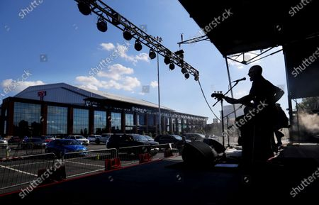 Jon Jones sings with the Eli Young Band during a concert in the parking lot outside of Globe Life Field in Arlington, Texas