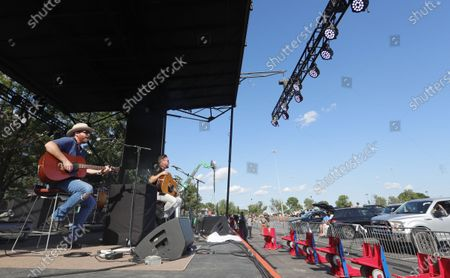 Stock Image of Members of the Eli Young Band, Mike Eli, left, and James Young perform during a concert in the parking lot outside of Globe Life Field in Arlington, Texas