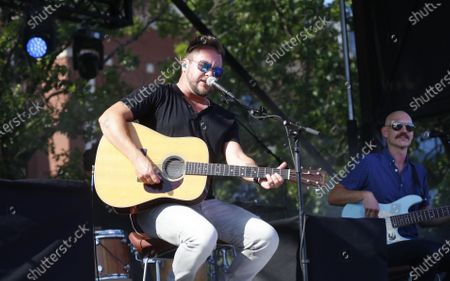 Mike Eli, left, and Jon Jones perform in the parking lot outside of Globe Life Field in Arlington, Texas, . The The Eli Young Band performed as part of the Concert in Your Car series at the new Texas Rangers stadium