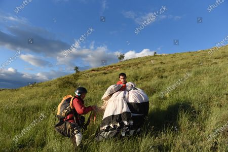 Two men prepare to take off for a paragliding fly near a small village of Perdices during the coronavirus crisis. This region is one of the Europe's largest desert in terms of population with just 8.8 inhabitants per sq km in phase 2 of Spain's de-escalation plan due to the covid-19 pandemic, From Monday, June 8, under this phase, regions will be able to decide whether classes should restart in schools or not, social gatherings of up to 15 people are allowed and there are no restrictions on outdoor activities.
