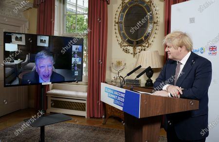 British Prime Minister Boris Johnson (R) watches the speech of Bill Gates during the virtual Global Vaccine Summit at 10 Downing Street in London, Britain, on June 4, 2020. British Prime Minister Boris Johnson opened the Global Vaccine Summit virtually on Thursday, urging countries and organizations to pledge funding for vaccinations to save millions of lives in the poorest countries and protect the world from future outbreaks of infectious diseases.