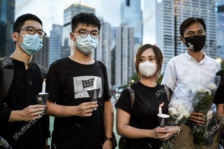 From left L Nathan Law Kwun-chung, Joshua Wong Chi-fing, Tiffany Yuen Ka-wai and Eddie Chu Hoi-dick holding their candles during the 31st Anniversary of the Tiananmen Massacre.Thousands gathered for the annual memorial vigil in Victoria Park to mark the 1989 Tiananmen Square Massacre despite a police ban citing coronavirus social distancing restrictions.