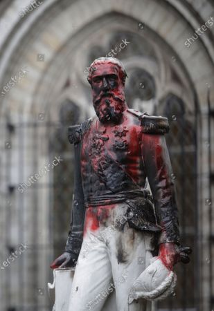 A view of a defaced statue of King Leopold II of Belgium, after it was set on fire and smeared with red paint, in Ekeren, Antwerp, Belgium, 05 June 2020. At least two petitions were launched to remove all statues in honor of the colonial-era monarch due to historical atrocities committed in his name in his former colony Congo, reports state. The petitions to remove the monuments were launched amidst worldwide anti-racist protests following the death of George Floyd, a black US citizen who died after a white policeman kneeled on his neck for several minutes, reports state.