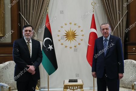 Turkish President Recep Tayyip Erdogan (R) meets with visiting Libya's UN-recognized Government of National Accord (GNA) Prime Minister Fayez al-Sarraj at the presidential palace in Ankara, Turkey, on June 4, 2020. Turkey and Libya agreed to further enhance their cooperation in the Eastern Mediterranean over a deal made on maritime delimitation, Turkish President Recep Tayyip Erdogan said on Thursday.