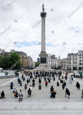 People take part in Worldwide Kneel in Trafalgar Square in solidarity with Black Lives Matter