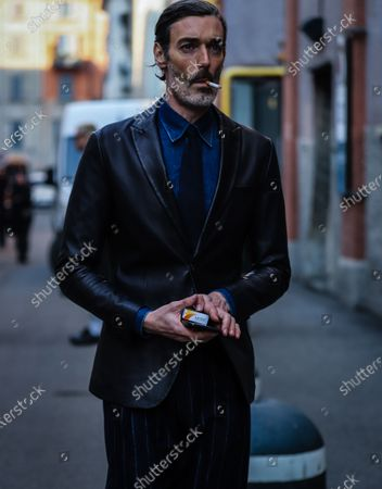 Stock Photo of MILAN, Italy- January 13 2020: Richard Biedul on the street during the Milan Fashion Week.
