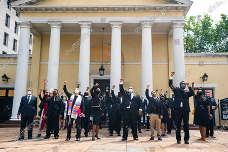 DC religious leaders raise their fists outside Saint John Church after volunteers, with permission from the city, painted 'Black Lives Matter' on 16th St. across from the White House, the location of seven days of protests in DC over the death of George Floyd, who died in police custody, in Washington, DC, USA, 05 June 2020. DC Mayor Muriel Bowser later renamed that section of 16th Street Black Lives Matter Plaza.