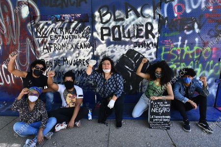 A Black Live Matter protester takes part during demonstration against the racism and police brutality at US Embassy after the killing of George Floyd, 49, by a Minneapolis police man kneeled on his neck for 8.46 minutes killing him whilst beign arrested  last week. His dead has caused civil unrest.