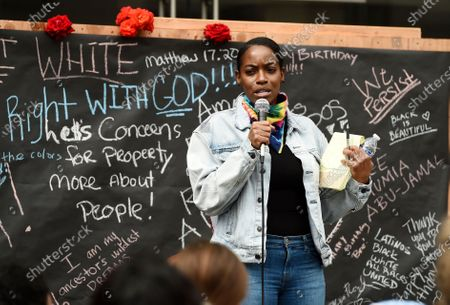 Stock Image of Actress Milauna Jackson addresses protesters at a rally in support of Black Lives Matter outside the Academy of Motion Picture Arts & Sciences, in Beverly Hills, Calif. Protests continue to be held in U.S. cities over the death of George Floyd, a black man who died after being restrained by Minneapolis police officers on May 25
