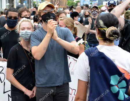 Joe Keery and Maika Monroe at a protest in honor of Breonna Taylor's birthday