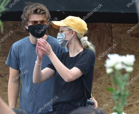 Stock Image of Joe Keery and Maika Monroe at a protest in honor of Breonna Taylor's birthday