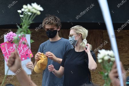 Stock Photo of Joe Keery and Maika Monroe at a protest in honor of Breonna Taylor's birthday