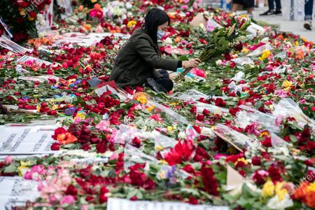 A protester displays flowers as thousands of roses are laid on the pavement in front of the Hall of Justice, the 'RoseFromConcrete' action inspired by a poem by late rapper Tupac Shakur, while hundreds continue demonstrating over the arrest in Minnesota of George Floyd, who later died in police custody, in Los Angeles, California, USA, 05 June 2020. A bystander's video posted online on 25 May, appeared to show George Floyd, 46, pleading with arresting officers that he couldn't breathe as an officer knelt on his neck. The unarmed black man later died in police custody.