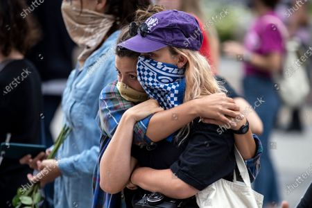 Two protesters react as they look at thousands of roses laid on the pavement in front of the Hall of Justice, the 'RoseFromConcrete' action inspired by a poem by late rapper Tupac Shakur, while hundreds continue demonstrating over the arrest in Minnesota of George Floyd, who later died in police custody, in Los Angeles, California, USA, 05 June 2020. A bystander's video posted online on 25 May, appeared to show George Floyd, 46, pleading with arresting officers that he couldn't breathe as an officer knelt on his neck. The unarmed black man later died in police custody.