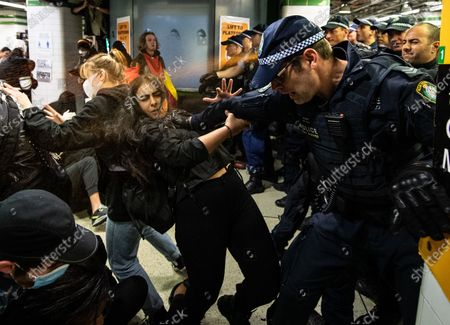 Police spraying protesters with pepper spray inside Central Station after a Black Lives Matter rally in Sydney, Australia, 06 June 2020, a protest against the deaths of Aboriginal people in custody and solidarity with the US protests for George Floyd.