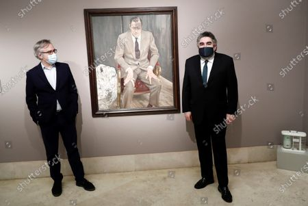 Spanish Culture Minister, Jose Manuel Rodriguez Uribes (R), and the director of the Thyssen-Bornemisza Museum, Guillermo Solana (L), pose next to the portrait of Baron Thyssen-Bornemisza by artist Lucian Freud, during the museum's reopening day in Madrid, Spain, 06 June 2020. El Prado, Thyssen-Bornemisza and Reina Sofia Museums are reopening 06 June 2020 in the Spanish capital with new security measures in place due to the coronavirus health crisis.