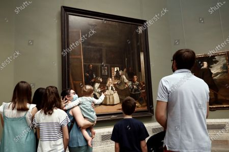 Visitors look at the painting 'Las Meninas' by artist Diego Velazquez in El Prado Museum on its reopening day in Madrid, Spain, 06 June 2020. El Prado, Thyssen-Bornemisza and Reina Sofia Museums are reopening 06 June 2020 in the Spanish capital with new security measures in place due to the coronavirus health crisis.