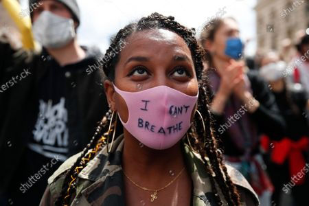 """Woman wears a face mask reading """"I Can't Breathe"""" during a demonstration in Paris, France, to protest against the recent killing of George Floyd, a black man who died in police custody in Minneapolis, U.S.A., after being restrained by police officers on May 25, 2020. Paris police have banned a third protest that had been planned for Saturday to condemn alleged police abuses in the wake of Floyd's death"""