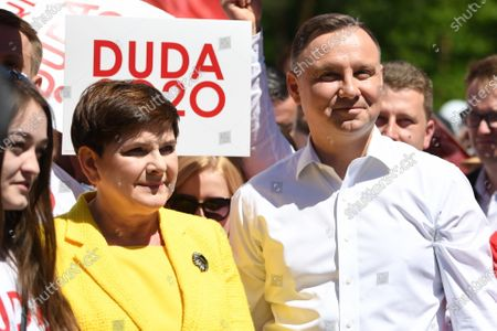 Polish President and candidate for Poland's president of main rulling party Law and Justice (PiS) Andrzej Duda (R) and former Polish Prime Minister Beata Szydlo (L) attend his meeting with local residents during his visit in Stalowa Wola, eastern Poland, 06 June 2020. Poland will hold its presidential election on 28 June 2020. Poles will be able to vote in polling stations with adherence to a strict sanitary regime, or by postal vote.