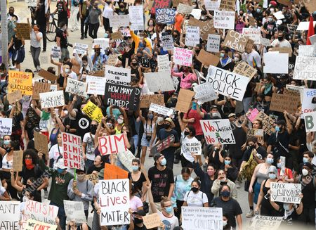 Protestors are seen holding signs and demonstrating during the protests for George Floyd, Wynwood, Florida, USA - 05 Jun 2020