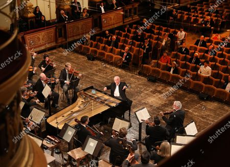 Stock Image of Conductor Daniel Barenboim (C) and the Vienna Philharmonic Orchestra perform at the golden hall of Vienna's Musikverein in Vienna, Austria, on June 5, 2020.   The first concert of the Vienna Philharmonic Orchestra was held on Friday after a COVID-19 lockdown at Vienna's Musikverein. Only 100 guests are allowed in the concert hall because of government regulations.
