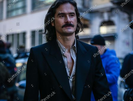 Stock Picture of MILAN, Italy- February 21 2020: Ben Cobb on the street during the Milan Fashion Week.