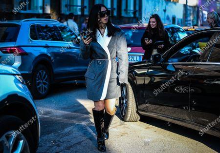MILAN, Italy- February 21 2020: Yuwei Zhangzou on the street during the Milan Fashion Week.