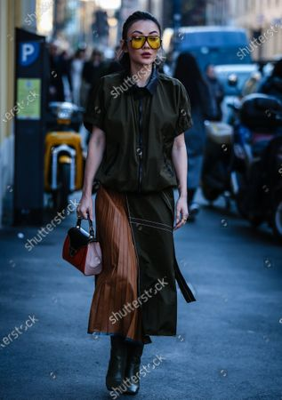 MILAN, Italy- February 21 2020: Jessica Wang on the street during the Milan Fashion Week.