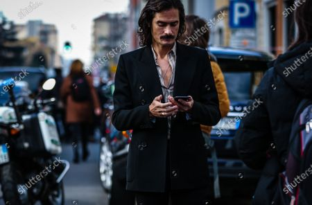 MILAN, Italy- February 21 2020: Ben Cobb on the street during the Milan Fashion Week.