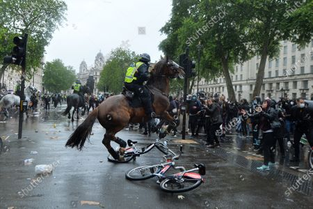 Mounted police try to clear a demonstration against racism on Whitehall, London.