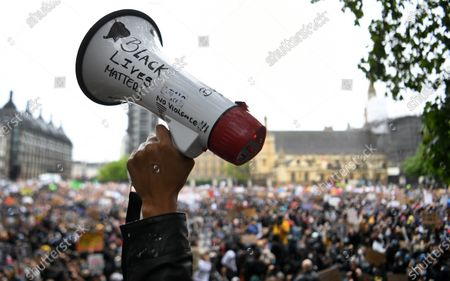 An activist holds up a megaphone as thousands of people defy the coronavirus lockdown order to take part in a 'Black Lives Matter' (BLM) protest at Parliament Square in London, Britain, 06 June 2020. The anti-racism demonstration was held to condemn the killing of George Floyd, a 46-year-old African-American man who died on 25 May after being detained by police officers in Minneapolis (Minnesota), USA, and to express solidarity with the BLM-led protests currently taking place throughout the US. Video footage recorded by bystanders appeared to show police officer Derek Chauvin forcefully kneeling on Floyd's neck for several minutes while the latter pleaded that he couldn't breathe and three other officers passively looked on. Outrage over this new alleged killing of an unarmed black man at the hands of US police has spread across the country and abroad, giving rise to many spontaneous protests around the globe and some riots in major American cities.