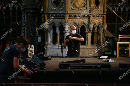 Stock Photo of Crew prepare the stage wearing face masks in preparation for singer Laura Marling performance at the Union Chapel in north London, . The concert is set to be live-streamed online to a limited number of ticket holders