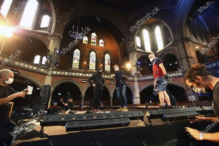 Stock Image of Crew prepare the stage wearing face masks in preparation for singer Laura Marling performance at the Union Chapel in north London, . The concert is set to be live-streamed online to a limited number of ticket holders