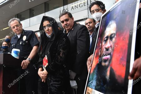 LAPD Chief Michael Moore, left, holds a press conference with community leaders outside police headquarters after a candle light vigil for George Floyd Friday.