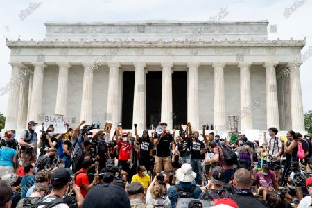 Protestors gather at the Lincoln Memorial for a protest against systemic inequality and police brutality