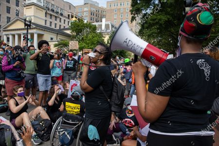 Disability advocates rallied a crowd outside of the White House during a march against police brutality and racism