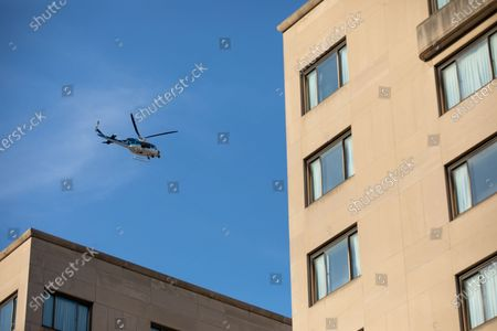 A U.S. Park Police helicopter flies above a march against police brutality and racism