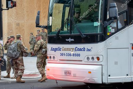 U.S. Air Force members prepare to leave in a bus during a march against police brutality and racism