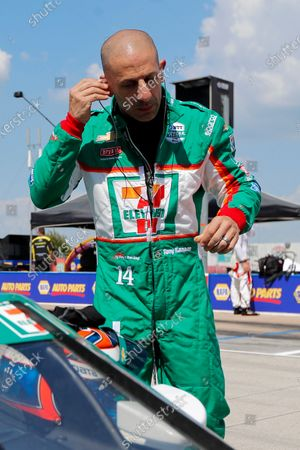 Tony Kanaan stands on pit road as he prepares for qualifying for an IndyCar auto race at Texas Motor Speedway in Fort Worth, Texas